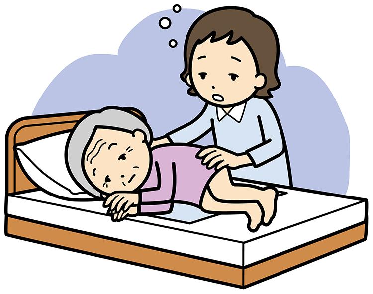Pflegerin wechselt schlafender Bewohnerin Inkoprodukt