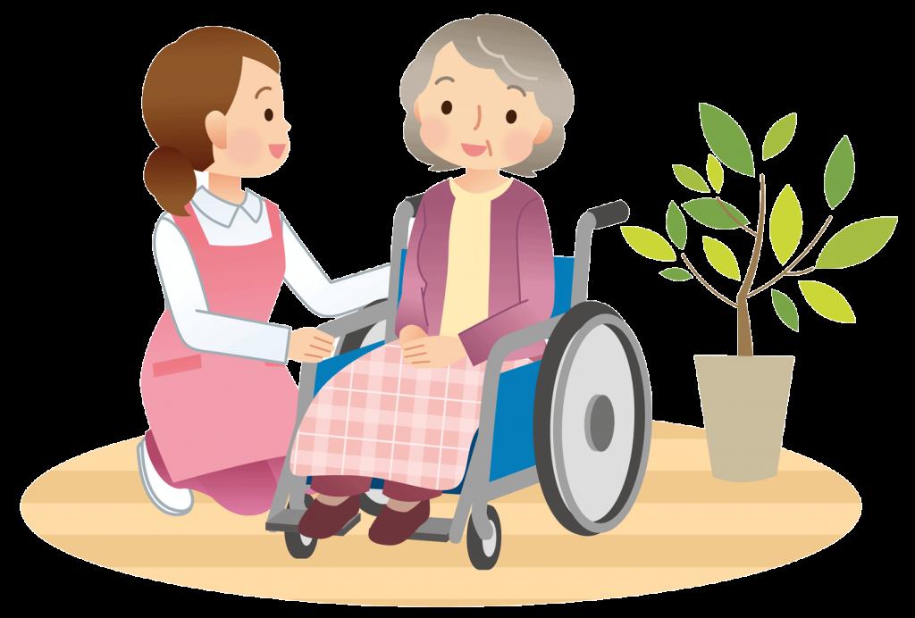 Pflegerin kümmert sich um Bewohnerin im Rollstuhl